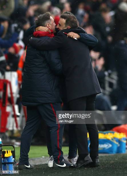 Carlos Carvalhal Manager of Swansea City celebrates his sides second goal with his backroom staff during the Premier League match between Swansea...