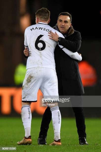 Carlos Carvalhal Manager of Swansea City embraces Alfie Mawson following the Premier League match between Swansea City and Liverpool at Liberty...
