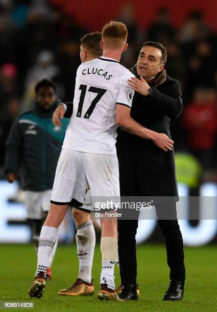 Carlos Carvalhal Manager of Swansea City embraces Samuel Clucas following the Premier League match between Swansea City and Liverpool at Liberty...