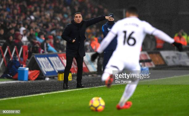 Carlos Carvalhal Manager of Swansea City gives his team instructions during the Premier League match between Swansea City and Tottenham Hotspur at...
