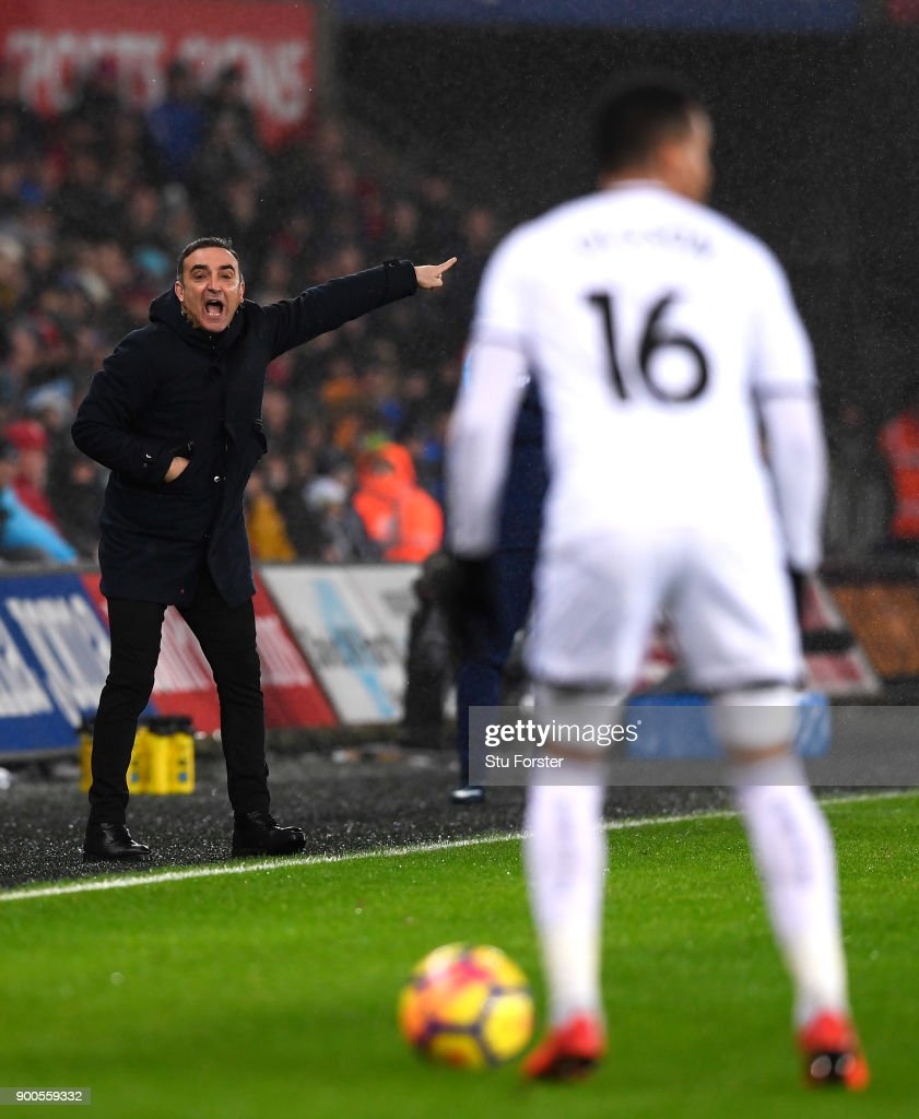 Carlos Carvalhal, Manager of Swansea City gives his team instructions during the Premier League match between Swansea City and Tottenham Hotspur at Liberty Stadium on January 2, 2018 in Swansea, Wales.