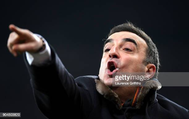 Carlos Carvalhal Manager of Swansea City gives his team instructions during the Premier League match between Newcastle United and Swansea City at St...
