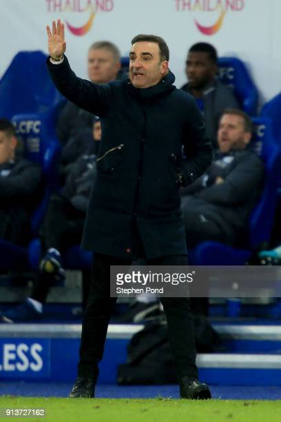 Carlos Carvalhal Manager of Swansea City gives his team instructions during the Premier League match between Leicester City and Swansea City at The...