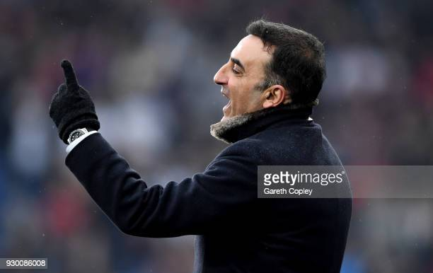Carlos Carvalhal Manager of Swansea City gives his team instructions during the Premier League match between Huddersfield Town and Swansea City at...