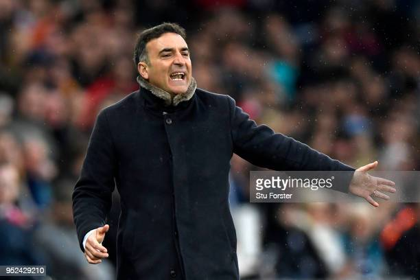 Carlos Carvalhal Manager of Swansea City gives his team instructions during the Premier League match between Swansea City and Chelsea at Liberty...