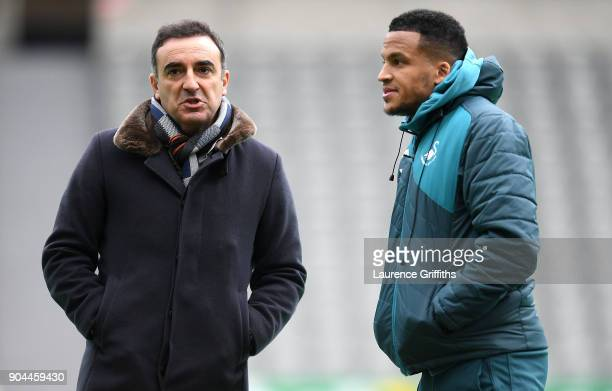 Carlos Carvalhal Manager of Swansea City in discussion with Martin Olsson of Swansea City prior to the Premier League match between Newcastle United...