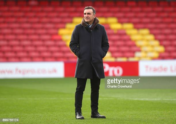 Carlos Carvalhal Manager of Swansea City inspects the pitch prior to the Premier League match between Watford and Swansea City at Vicarage Road on...