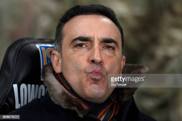 Carlos Carvalhal Manager of Swansea City looks on ahead of the Premier League match between Swansea City and Liverpool at Liberty Stadium on January...