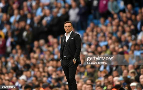 Carlos Carvalhal Manager of Swansea City looks on during the Premier League match between Manchester City and Swansea City at Etihad Stadium on April...