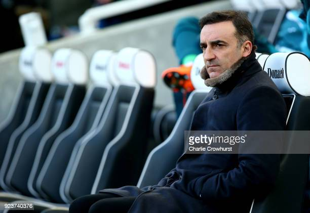 Carlos Carvalhal Manager of Swansea City looks on from the bench prior to the Premier League match between Brighton and Hove Albion and Swansea City...