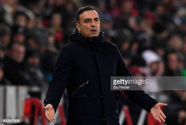 Carlos Carvalhal Manager of Swansea City reacts during the Premier League match between Swansea City and Tottenham Hotspur at Liberty Stadium on...