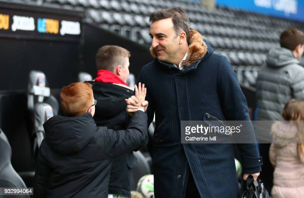 Carlos Carvalhal Manager of Swansea City shake hands with fans as he arrives prior to The Emirates FA Cup Quarter Final match between Swansea City...