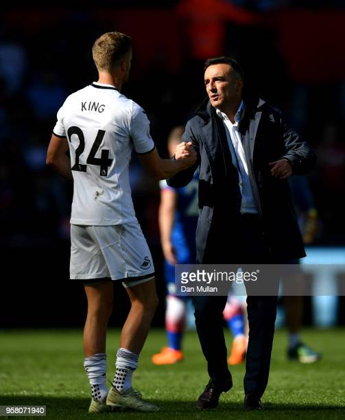 Carlos Carvalhal Manager of Swansea City shakes hands with Andy Kinag of Swansea City after the Premier League match between Swansea City and Stoke...