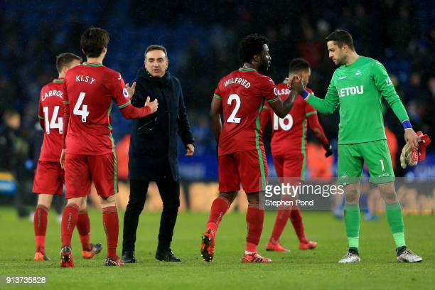Carlos Carvalhal Manager of Swansea City shakes hands with players following the Premier League match between Leicester City and Swansea City at The...