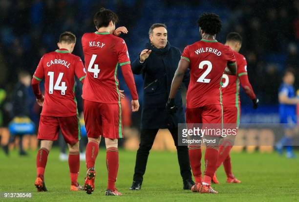 Carlos Carvalhal Manager of Swansea City shakes hands with team following the Premier League match between Leicester City and Swansea City at The...