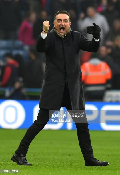 Carlos Carvalhal Manager of Swansea City shows appreciation to the fans after the Premier League match between Huddersfield Town and Swansea City at...