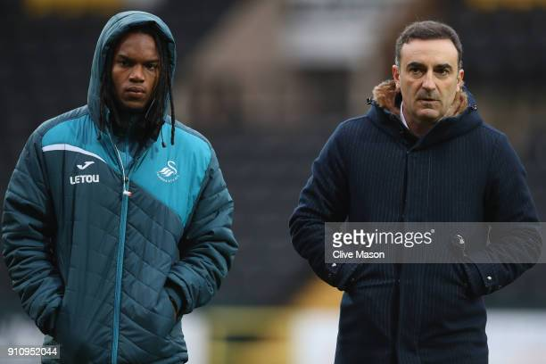 Carlos Carvalhal Manager of Swansea City speaks with Renato Sanchez of Swansea City during The Emirates FA Cup Fourth Round match between Notts...