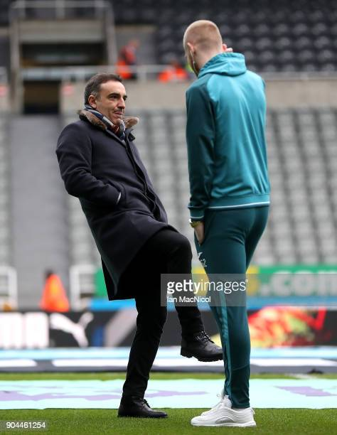 Carlos Carvalhal Manager of Swansea City talks with Oliver McBurnie of Swansea City prior to the Premier League match between Newcastle United and...