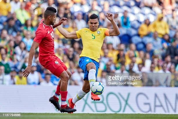 Carlos Casemiro of Brazil competes for the ball with Omar Browne of Panama during the International Friendly match between Brazil and Panama at...