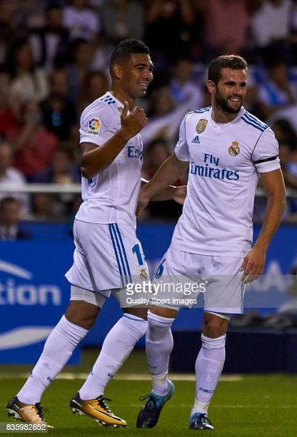 Carlos Casemiro of Real Madrid and Nacho Fernandez of Real Madrid celebrate after scoring the second goal during the La Liga match between Deportivo...