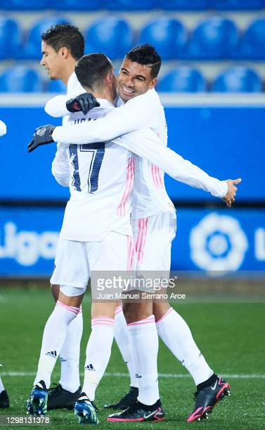 Carlos Casemiro of Real Madrid celebrates with his teammate Lucas Vazquez of Real Madrid after scoring the opening goal during the La Liga Santander...