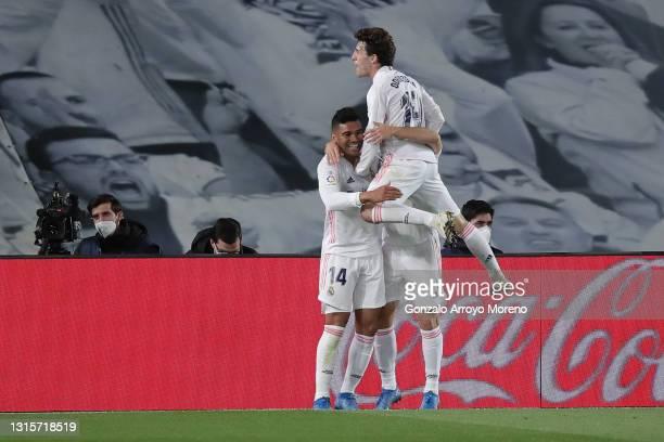 Carlos Casemiro of Real Madrid CF celebrates scoring their second goal with teammates Miguel Gutierrez and Alvaro Odriozola during the La Liga...