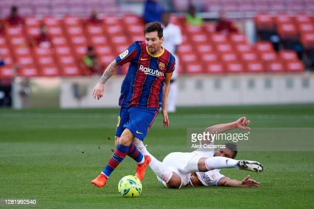 Carlos Casemiro of Real Madrid CF tackles Lionel Messi of FC Barcelona during the La Liga Santander match between FC Barcelona and Real Madrid at...