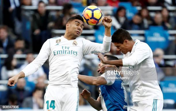 Carlos Casemiro of Real Madrid in action against Florin Andone of Deportivo La Coruna during the La Liga match between Real Madrid and Deportivo La...