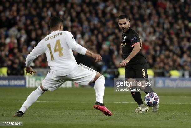 Carlos Casemiro of Real Madrid in action against Ilkay Gundogan of Manchester City during the UEFA Champions League round of 16 first leg soccer...