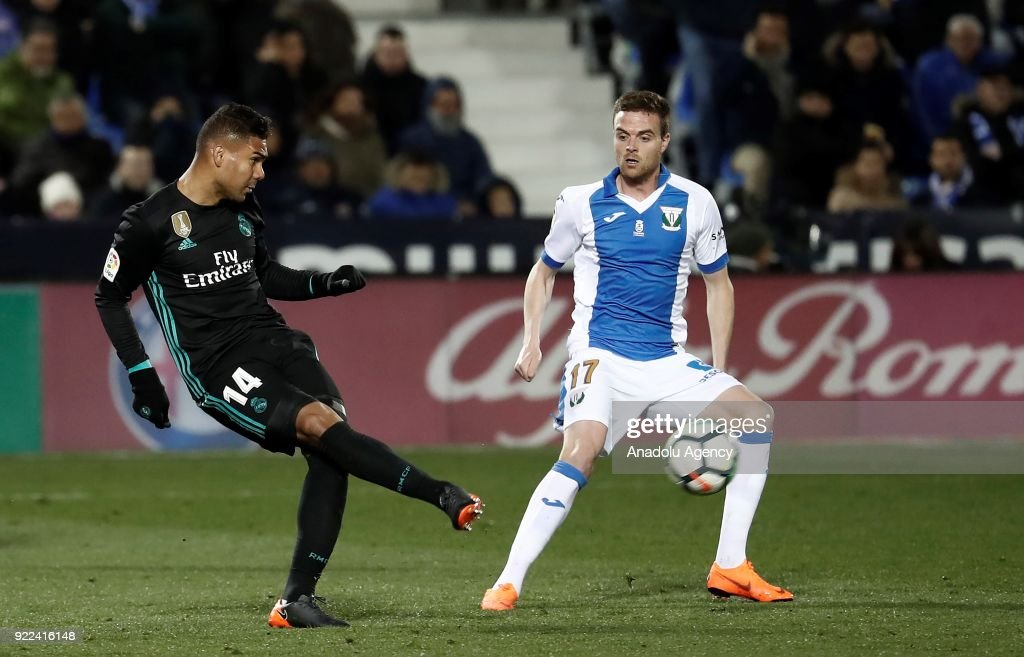 Carlos Casemiro of Real Madrid in action against Javi Eraso of Leganes during the La Liga football match between Leganes and Real Madrid at the Estadio Municipal Butarque in Madrid, Spain on February 21, 2018.