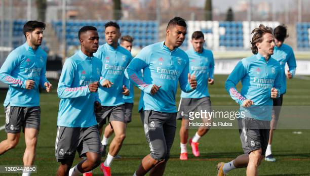 Carlos Casemiro running with Vini Jr. And luka Modric from Real Madrid at Valdebebas training ground on February 16, 2021 in Madrid, Spain.