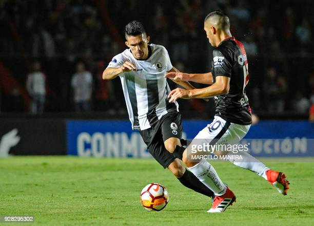 Carlos Castro of Venezuela's Zamora and Cristian Guanca of Argentina's Colon vie for the ball during their Copa Sudamericana football match at the...