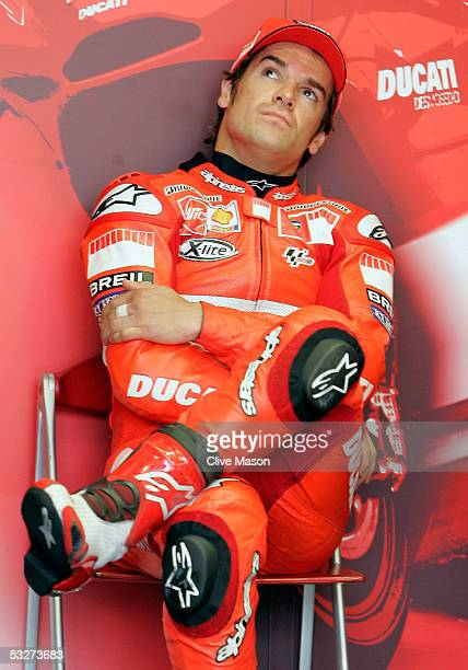 Carlos Checa of Spain and Ducati in the garage during second free practice for the British Moto GP at Donington Park on July 22 in Donington England