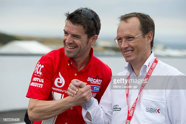Carlos Checa of Spain and Team Ducati Alstare poses with Javier Alonso of Spain during the event Track lap on bicycles at Phillip Island Grand Prix...