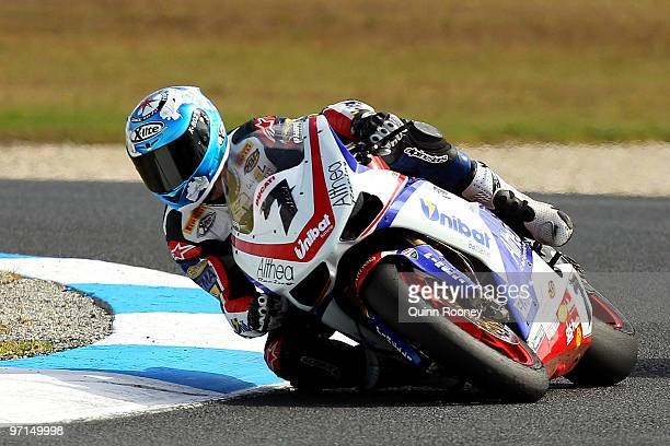 Carlos Checa of Spain and the Althea Racing Team rounds the bend during the Superbike World Championship round one race two at Phillip Island Grand...