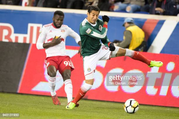 Carlos Cisneros of CD Guadalajara defends agains Kemar Lawrence of New York Red Bulls during the New York Red Bulls Vs CD Guadalajara CONCACAF...
