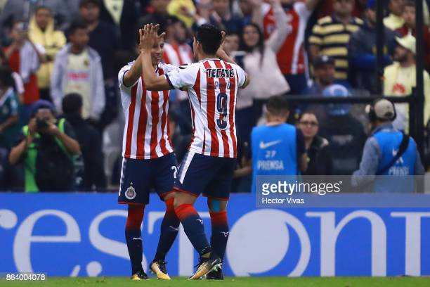 Carlos Cisneros of Chivas celebrate with teammates after scoring the first goal of his team during the 10th round match between America and Chivas as...