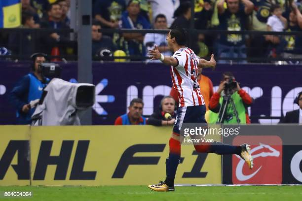 Carlos Cisneros of Chivas celebrates after scoring the first goal of his team during the 10th round match between America and Chivas as part of the...