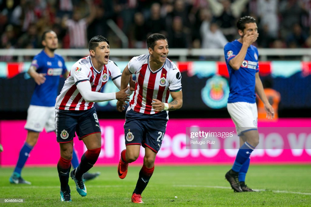 Carlos Cisneros of Chivas celebrates with teammates after scoring the first goal of his team during the 2nd round match between Chivas and Cruz Azul as part of the Torneo Clausura 2018 Liga MX at Akron Stadium on January 13, 2018 in Zapopan, Mexico.