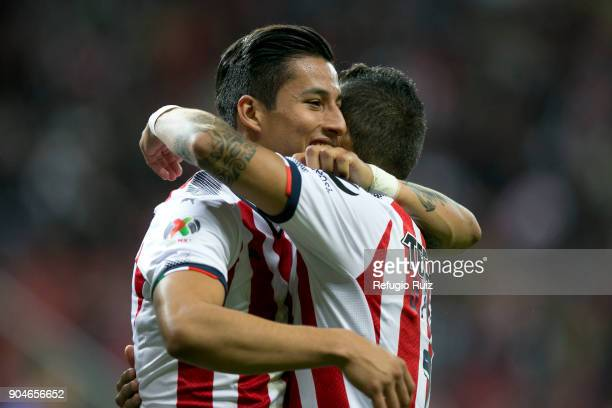 Carlos Cisneros of Chivas celebrates with teammates after scoring the first goal of his team during the 2nd round match between Chivas and Cruz Azul...