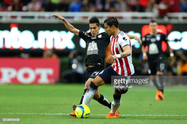 Carlos Cisneros of Chivas fights for the ball with Erick Aguirre of Pachuca during the 8th round match between Chivas and Pachuca as part of the...