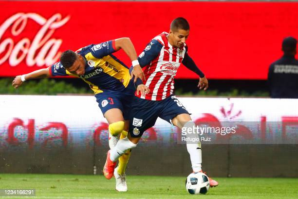 Carlos Cisneros of Chivas fights for the ball with Jesús Piñuelas of Atletico San Luis during the 1st round match between Chivas and Atletico San...