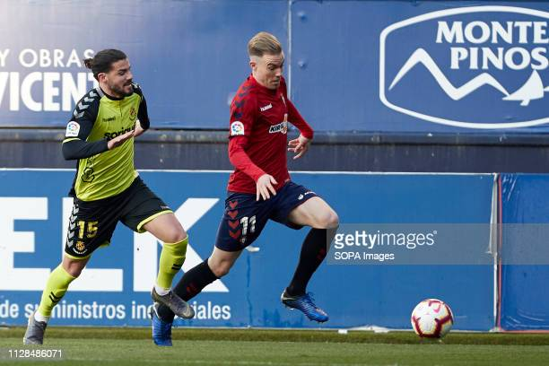 Carlos Clerc and Pipa are seen in action during the Spanish football of La Liga 123, match between CA Osasuna and Nastic of Tarragona at the Sadar...