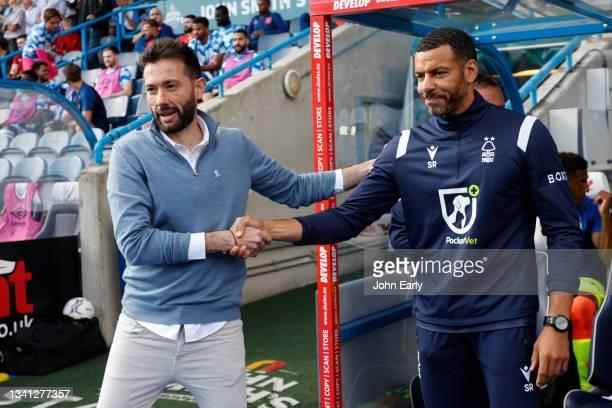 Carlos Coberán the Head Coach of Huddersfield Town greets Steven Reid the caretaker Head Coach of Nottingham Forest during the Sky Bet Championship...
