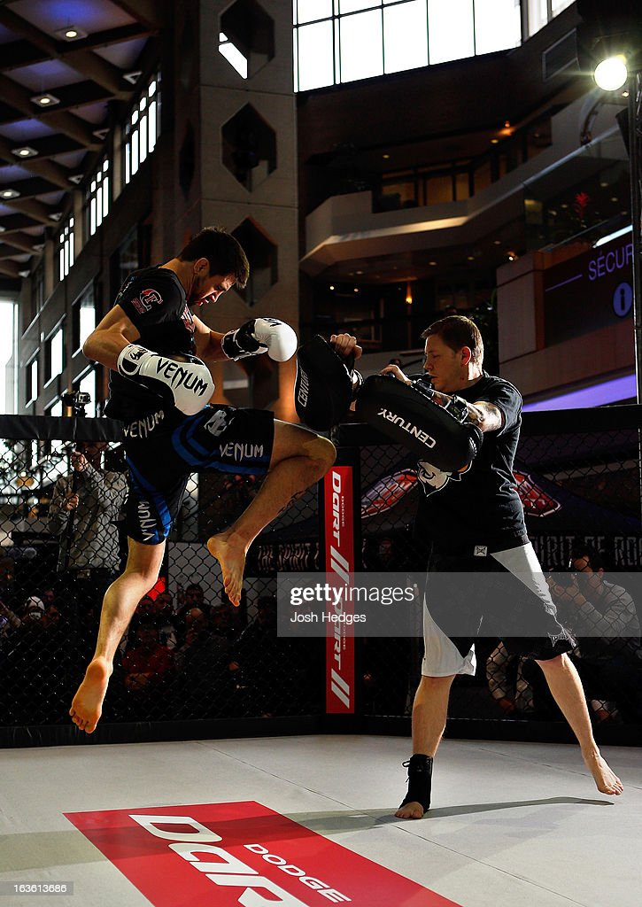 Carlos Condit (L) conducts an open training session for fans and media ahead of his UFC 158 bout at Complexe Desjardins on March 13, 2013 in Montreal, Quebec, Canada.