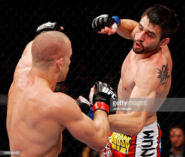 Carlos Condit fights against Georges StPierre in their welterweight title bout during UFC 154 on November 17 2012 at the Bell Centre in Montreal...