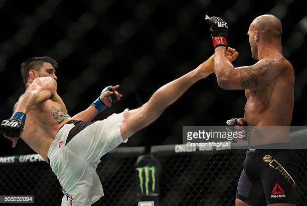 Carlos Condit kicks Robbie Lawler in their welterweight championship fight during the UFC 195 event inside MGM Grand Garden Arena on January 2, 2016...