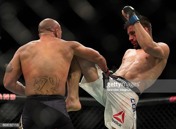 Carlos Condit knees Robbie Lawler in their welterweight championship fight during the UFC 195 event inside MGM Grand Garden Arena on January 2, 2016...