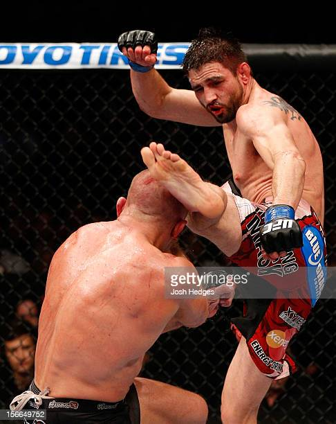 Carlos Condit lands a left footed kick to the head of Georges StPierre in their welterweight title bout during UFC 154 on November 17 2012 at the...
