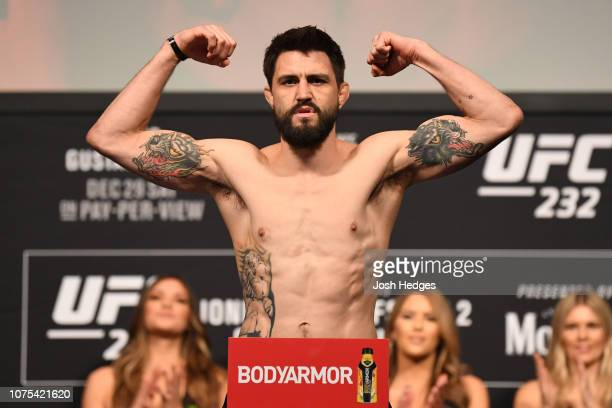 Carlos Condit poses on the scale during the UFC 232 weighin inside The Forum on December 28 2018 in Inglewood California